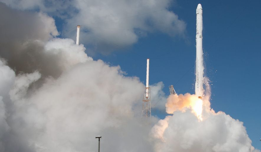 Earlier this year California-based enterprise SpaceX launched the Dragon, a two-stage Falcon 9 rocket carrying unmanned cargo to the International Space Station. The company is hoping to help the U.S. lead the space race with reusable rockets. (Associated Press)