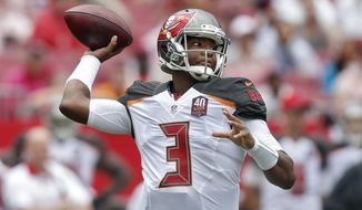 Tampa Bay Buccaneers quarterback Jameis Winston (3) throws a pass against the Carolina Panthers during the first quarter of an NFL football game Sunday, Oct. 4, 2015, in Tampa, Fla. (AP Photo/Brian Blanco)