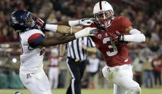 Stanford's Michael Rector (3) stiff arms Arizona 's DaVonte' Neal on an 18-yard touchdown reception during the second half of an NCAA college football game Saturday, Oct. 3, 2015, in Stanford, Calif.  (AP Photo/Marcio Jose Sanchez)