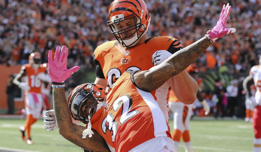 Cincinnati Bengals running back Jeremy Hill (32) reacts after scoring a touchdown in the second half of an NFL football game against the Kansas City Chiefs, Sunday, Oct. 4, 2015, in Cincinnati. (AP Photo/Gary Landers)