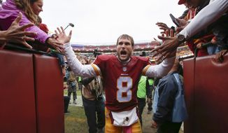 Washington Redskins quarterback Kirk Cousins (8) celebrates with fans as he leaves the field after an NFL football game against the Philadelphia Eagles in Landover, Md., Sunday, Oct. 4, 2015. The Redskins defeated the Eagles 23-20. (AP Photo/Alex Brandon)