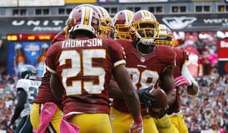Washington Redskins wide receiver Pierre Garcon (88) celebrates his touchdown with teammates during the second half of an NFL football game against the Philadelphia Eagles in Landover, Md., Sunday, Oct. 4, 2015. The Redskins defeated the Eagles 23-20. (AP Photo/Patrick Semansky)