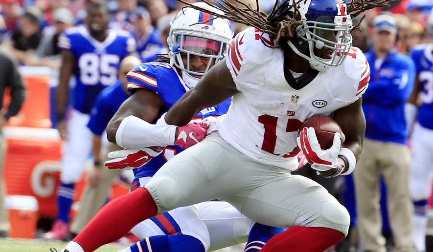 New York Giants wide receiver Dwayne Harris, front, is tackled by Buffalo Bills defensive back Nickell Robey during the first half of an NFL football game, Sunday, Oct. 4, 2015, in Orchard Park, N.Y. (AP Photo/Bill Wippert)