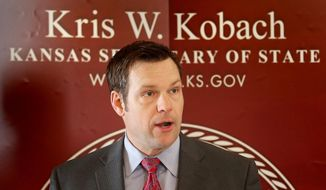 FILE - In this Tuesday, Feb. 17, 2015, file photo, Kansas Secretary of State Kris Kobach speaks during a news conference in Topeka, Kan. Kobach's successful push to require new Kansas voters to document their U.S. citizenship has spawned three lawsuits, including one from him. (Thad Allton/The Topeka Capital-Journal via AP) MANDATORY CREDIT