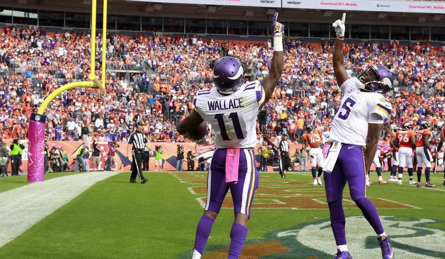 Minnesota Vikings wide receiver Mike Wallace, left, celebrates after scoring with quarterback Teddy Bridgewater during the first half of an NFL football game Sunday, Oct. 4, 2015, in Denver. (AP Photo/Jack Dempsey)