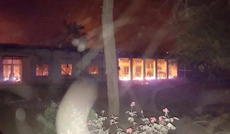 The Doctors Without Borders hospital in Kunduz, Afghanistan, erupted in flames after the Saturday airstrike. Army Gen. John Campbell said Afghan forces were taking fire and radioed for air support. (Associated Press)