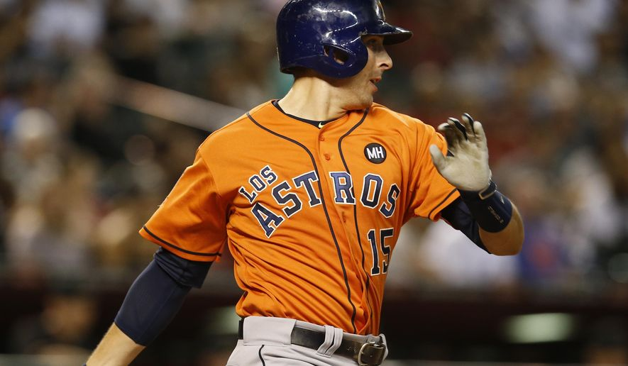 Houston Astros Jason Castro hits an RBI single in the seventh inning during a baseball game against the Arizona Diamondbacks, Saturday, Oct. 3, 2015, in Phoenix. (AP Photo/Rick Scuteri)