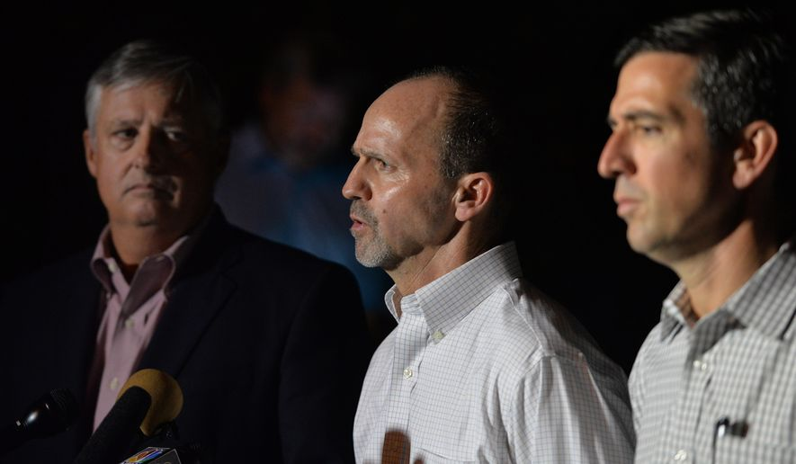 Phil Greene, president of TOTE Services & CEO, left, and Tim Nolan, president of TOTE Maritime Puerto Rico, right, listen as Anthony Chiarello, president & CEO, TOTE, Inc. speaks about about the missing cargo ship El Faro outside the Seafarer's International Union hall in Jacksonville, Fla., Sunday, Oct. 4, 2015. (Bruce Lipsky/The Florida Times-Union via AP)
