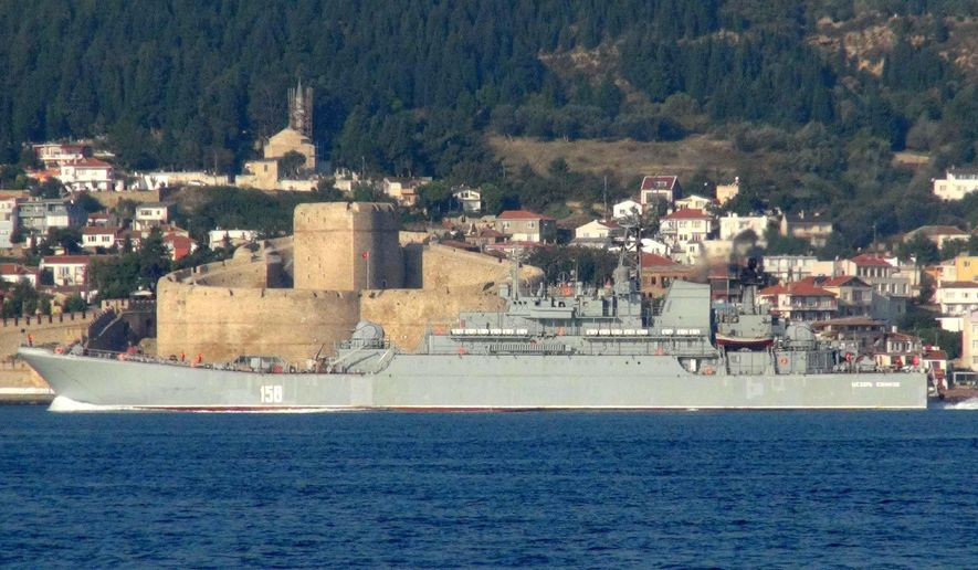 A Russian Navy ship named 'Caesar Kunikov' passes through the Dardanelles strait in Turkey en route to the Mediterranean Sea, Sunday, Oct. 4, 2015.  Russia began launching military operations in Syria on Wednesday. (Photo/Burak Gezen/DHA via AP) TURKEY OUT