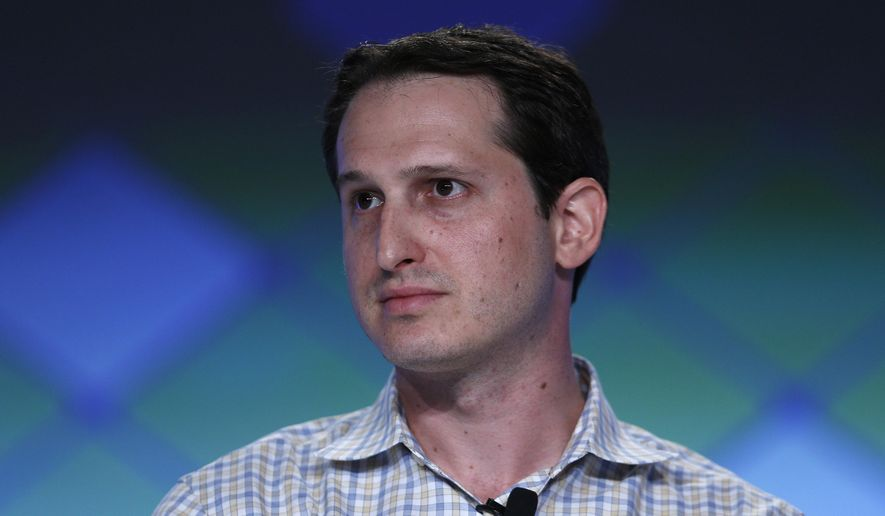 In this Sept. 29, 2015, photo, Jason Robins, center, CEO of DraftKings website, speaks on a panel at the Global Gaming Expo in Las Vegas. (AP Photo/John Locher) ** FILE **