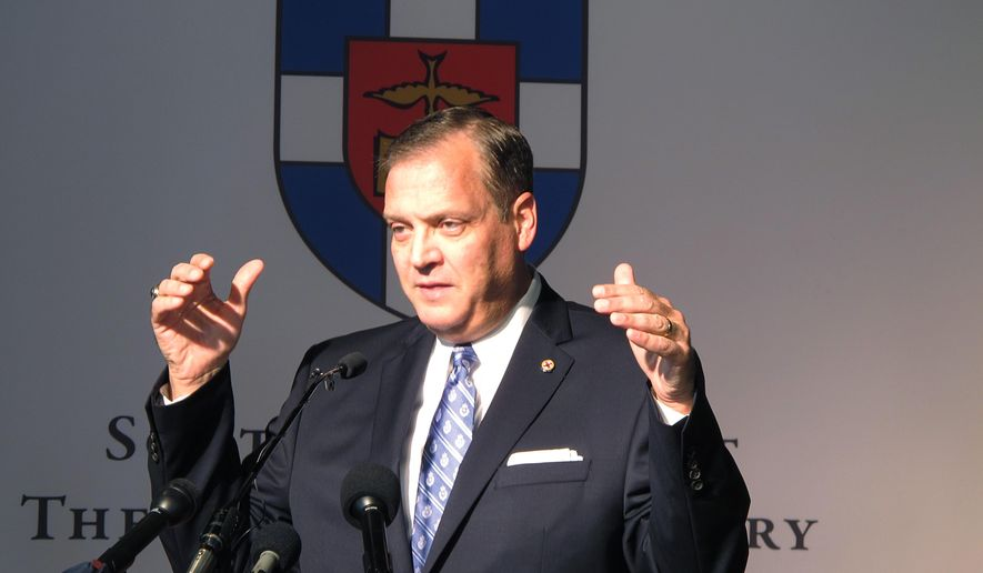 In this file photo, the Rev. R. Albert Mohler Jr., president of Southern Baptist Theological Seminary, speaks to reporters on Monday, Oct. 5, 2015 about a conference in Louisville, Ky., focusing on homosexuality and how to offer pastoral care to gays. On Feb. 15, 2019, Rev. Mohler issued an apology for having defended a fellow pastor who was accused of covering up sexual abuse of minors. (AP Photo/Bruce Schreiner)