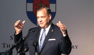 The Rev. R. Albert Mohler Jr., president of Southern Baptist Theological Seminary, speaks to reporters on Monday, Oct. 5, 2015 about a conference in Louisville, Ky., focusing on homosexuality and how to offer pastoral care to gays. (AP Photo/Bruce Schreiner)