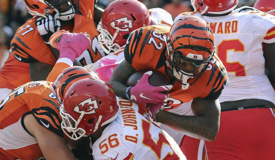 Cincinnati Bengals running back Jeremy Hill (32) goes up and over to score a touchdown in the second half of an NFL football game against the Kansas City Chiefs, Sunday, Oct. 4, 2015, in Cincinnati. (AP Photo/Gary Landers)