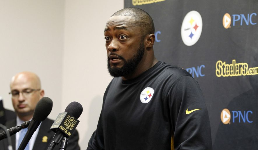 FILE - In this Sept. 27, 2015, file photo, Pittsburgh Steelers head coach Mike Tomlin speaks during a press conference following an NFL football game against the St. Louis Rams in St. Louis. Tomlin's questionable decisions in Pittsburgh's 23-20 loss to Baltimore kicked off Week 4 in the NFL. (AP Photo/Billy Hurst, File)