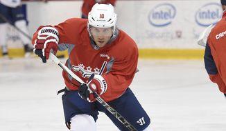 Washington Capitals' Derek Roy skates during Media Day at NHL hockey training camp, Friday, Sept. 18, 2015, in Arlington, Va. (AP Photo/Nick Wass)