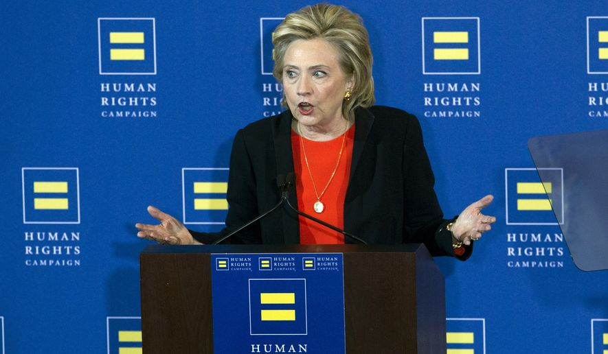 Democratic presidential candidate Hillary Rodham Clinton gestures as she speaks to the Human Rights Campaign in Washington, Saturday, Oct. 3, 2015. ( AP Photo/Jose Luis Magana)