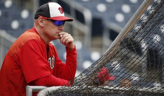 Washington Nationals manager Matt Williams (9) watches batting practice before a baseball game against the Chicago Cubs at Nationals Park, Friday, June 5, 2015, in Washington. (AP Photo/Alex Brandon)