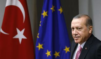 Turkish President Recep Tayyip Erdogan waits for the arrival of European Council President Donald Tusk prior to a meeting at the EU Council building in Brussels on Monday, Oct. 5, 2015. Erdogan is on a two-day visit to meet Belgian and EU officials. (Francois Lenoir, Pool photo via AP)