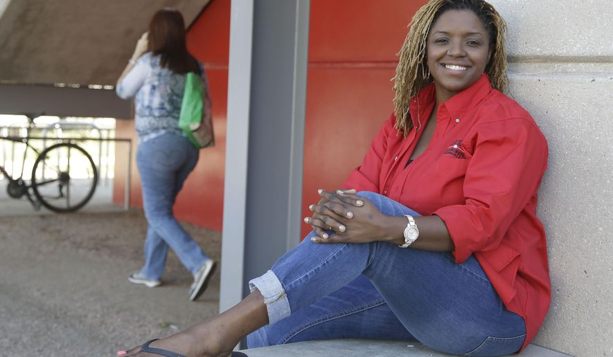 Roni Dean-Burren poses on the campus of the University oh Houston, Monday, Oct. 5, 2015, in Houston. Dean-Burren is asking publisher McGraw-Hill Education to change the text in a geography book that refers to slaves as workers from Africa. (AP Photo/Pat Sullivan)