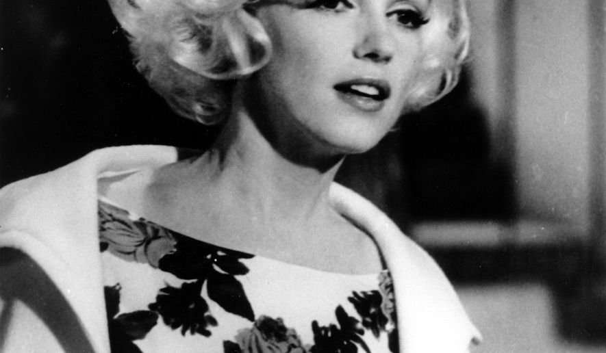 """FILE - This April 1962 file photo shows actress Marilyn Monroe on the set of her last movie, """"Something's Got To Give,"""" in Los Angeles. The city of Los Angeles trampled state and local laws when it approved demolition of a home where Monroe briefly lived to make way for a condominium project, a lawsuit charges. The Los Angeles Times reported Monday, Oct. 5, 2015, the house where the actress lived for one year was torn down days before a hearing on whether to consider making it a historic monument.  (AP Photo, File)"""