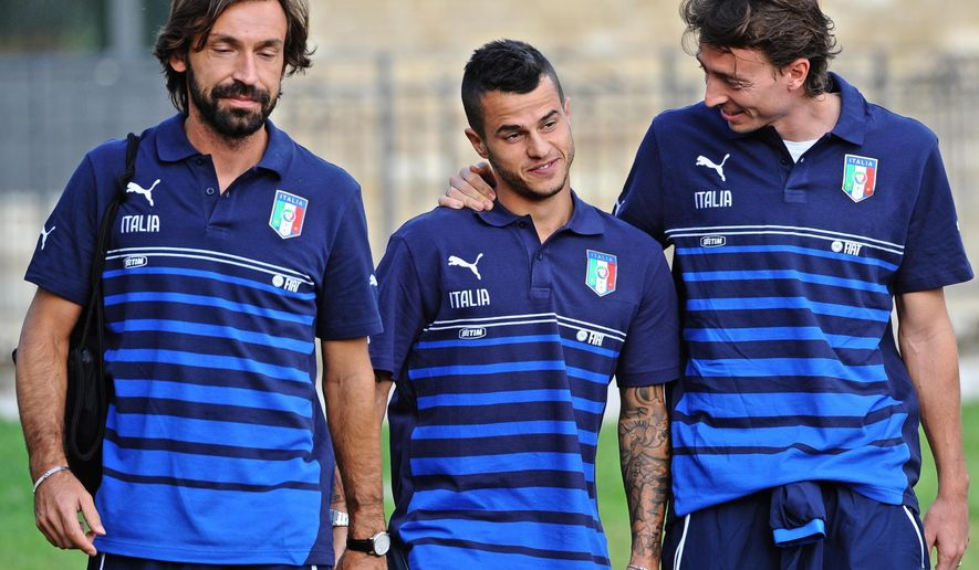 From left, Italy's Andrea Pirlo, Sebastian Giovinco and Riccardo Montolivo arrive for a training session ahead of Saturday's Euro 2016 qualifying match against Azerbajian, at the Coverciano center, near Florence, Italy, Monday, Oct. 5, 2015. (Maurizio Degl'Innocenti/ANSA via AP)