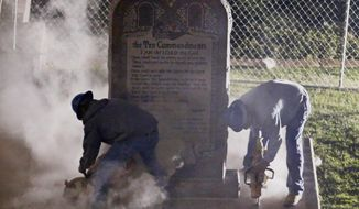 Workers remove the Ten Commandments monument from its base on the grounds of the state Capitol in Oklahoma City, Monday, Oct. 5, 2015. The removal comes after the Oklahoma Supreme Court's decision in June that the display violates a state constitutional prohibition on the use of public property. (AP Photo/Sue Ogrocki)