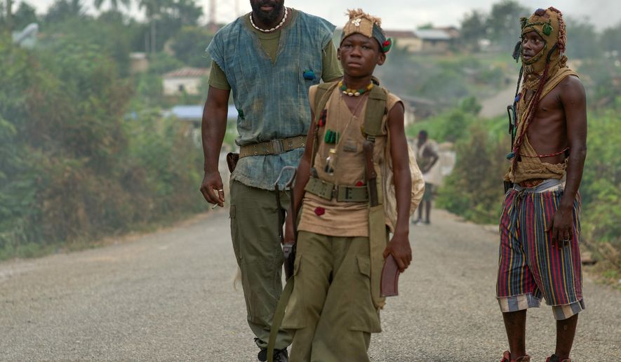 """This photo provided by Netflix shows Idris Elba, left, as Commandant, and Abraham Attah, center, as Agu, in the Netflix original film, """"Beasts of No Nation,"""" directed by Cary Fukunaga. (Shawn Greene/Netflix via AP)"""