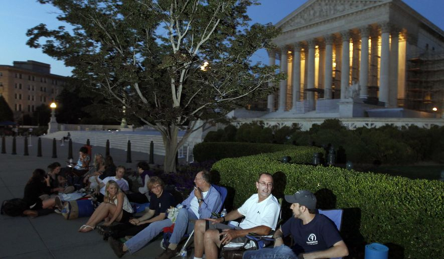 """FILE - In this June 27, 2012, file photo people line up in front of the U.S. Supreme Court on the eve of the expected ruling on whether or not the Affordable Care Act passes the test of constitutionality in Washington. The Supreme Court on Oct. 5, 2015, put a change in place that prohibits lawyers who are members of the Supreme Court bar from hiring """"line standers"""" to hold their place for seats to big arguments. The practice is common for congressional hearings, and has become more so in recent years for high-profile high court cases, including those involving gay marriage and the Obama health care overhaul. Lawyers who are part of the Supreme Court bar have access to a reserved section toward the front of the courtroom, and their odds of getting in are better than those for the general public. But now they will have to wait in line themselves if they want seats in the special section. (AP Photo/Alex Brandon, File)"""