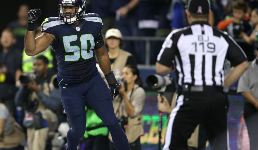 Seattle Seahawks outside linebacker K.J. Wright (50) celebrates after a play late in the fourth quarter of an NFL football game between the Seattle Seahawks and the Detroit Lions that was ruled a touchback after Lions wide receiver Calvin Johnson fumbled and the ball went out of bounds in the end zone, Monday, Oct. 5, 2015, in Seattle. The Seahawks beat the Lions 13-10. (AP Photo/Scott Eklund)