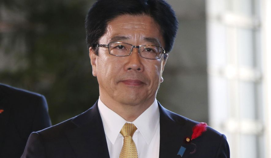 Japan's newly-appointed Minister in charge of Prime Minister Shinzo Abe's new economic revitalization measures, Katsunobu Kato arrives at the prime minister's official residence in Tokyo, Wednesday, Oct. 7, 2015.  Prime Minister Abe has reshuffled his Cabinet to focus on reviving the world's No. 3 economy.  (AP Photo/Koji Sasahara)