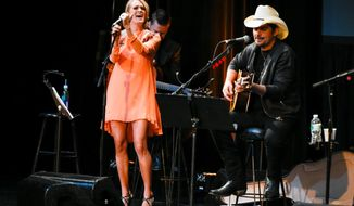 Singer Carrie Underwood, left, and musician Brad Paisley participate in the Country Music Hall of Fame benefit concert at PlayStation Theater on Tuesday, Oct. 6, 2015, in New York. (Photo by Evan Agostini/Invision/AP)