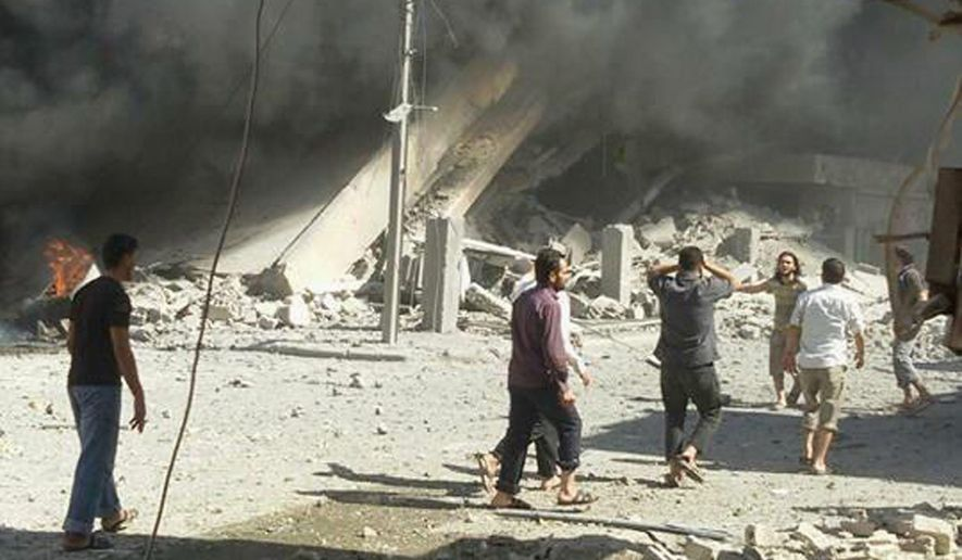 Russian warplanes have been hitting rebel-controlled areas including Homs. (Associated Press) ** FILE **