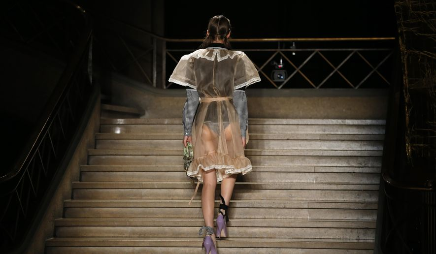 A model wears a creation for Miu Miu's Spring-Summer 2016 ready-to-wear fashion collection presented during the Paris Fashion Week, Wednesday, Oct. 7, 2015 in Paris, France. (AP Photo/Francois Mori)