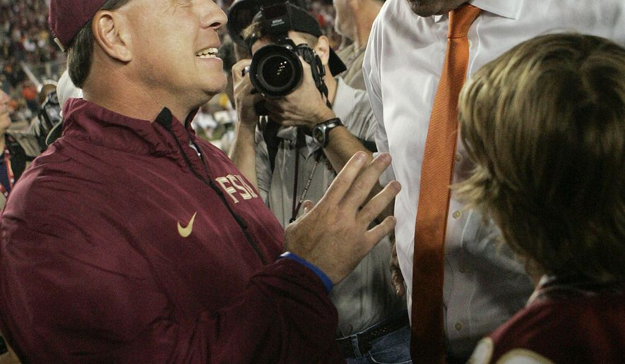 FILE - In this Nov. 2, 2013, file photo, Miami head coach Al Golden, right, talks to Florida State head coach Jimbo Fisher before the start of an NCAA college football game in Tallahassee, Fla. Florida State and Miami play Saturday, Oct. 10, 2015, in Tallahassee, (AP Photo/Steve Cannon, File)
