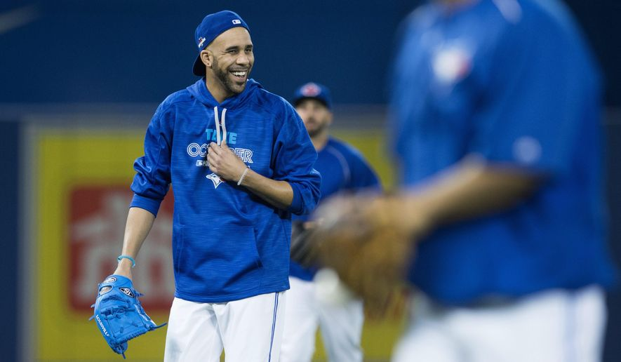 Toronto Blue Jays starting pitcher David Price laughs during a team workout at the Rogers Centre in Toronto on Wednesday, Oct. 7, 2015. The Blue Jays start the American League Divisional Series against the Texas Rangers in Toronto on Thursday. (Darren Calabrese/The Canadian Press via AP) MANDATORY CREDIT