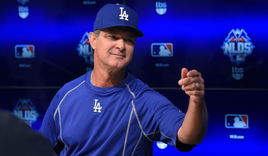 Los Angeles Dodgers manager Don Matingly talks to reporters prior to workouts in preparation for the National League Division Series against the New York Mets that is set to begin on Friday, Wednesday, Oct. 7, 2015, in Los Angeles. (AP Photo/Mark J. Terrill)