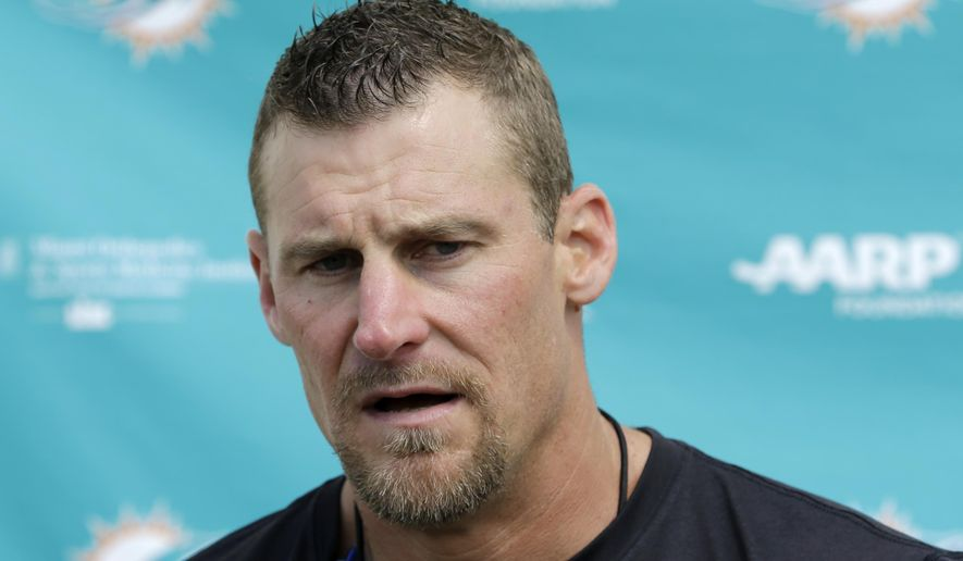 Miami Dolphins interim coach Dan Campbell talks to to reporters after NFL football practice Wednesday, Oct. 7, 2015, in Davie, Fla. (AP Photo/Alan Diaz)