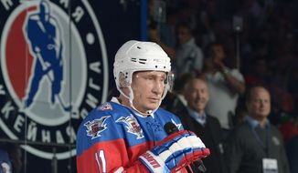 Russian President Vladimir Putin speaks before an ice hockey match between former NHL stars and officials at the Shayba Arena in the Black Sea resort of Sochi, Russia, Wednesday, Oct. 7, 2015. Russian President Vladimir Putin spent his 63rd birthday on the ice, playing hockey with NHL stars against Russian officials and tycoons. (Alexei Nikolsky/RIA-Novosti, Kremlin Pool Photo via AP)