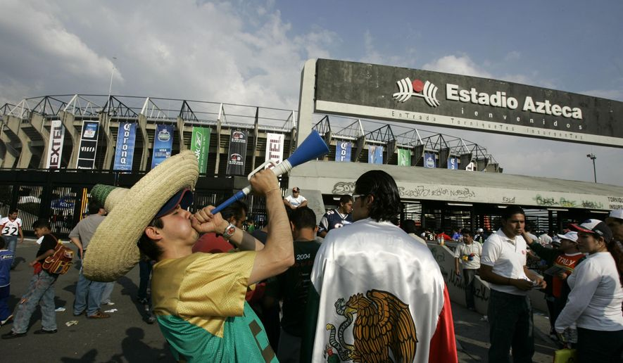 FILE - In this Oct. 2, 2005 file photo, a fan wearing a sombrero blows a horn outside of the Azteca Stadium in Mexico City, Mexico, before the start of the first regular-season NFL game between the Arizona Cardinals and 49ers. On Wednesday, Oct. 7, 2015, NFL owners approved more international games through 2025, including ones in places other than England, like Mexico and Germany.  (AP Photo/Eduardo Verdugo, File)