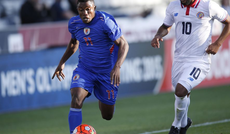 Haiti forward Christiano Francois, left, works the ball down the pitch as Costa Rica midfielder Dylan Flores pursues during the first half of a CONCACAF men's olympic qualifying soccer match Wednesday, Oct. 7, 2015, in Commerce City, Colo. (AP Photo/David Zalubowski)