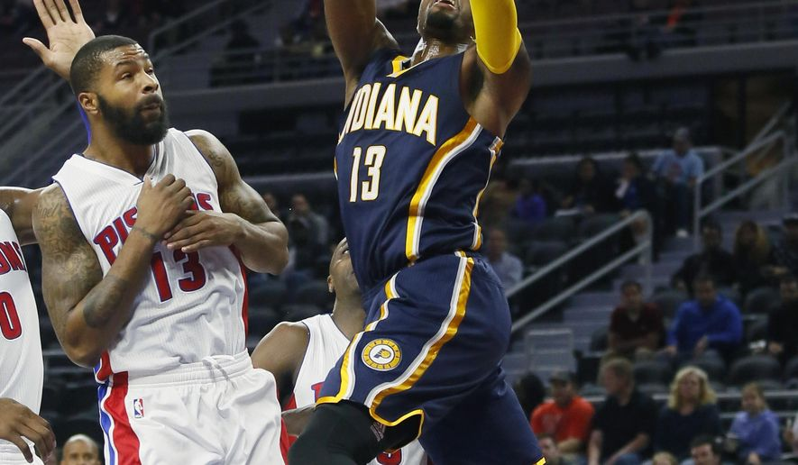 CORRECTS TO PAUL GEORGE FROM GEORGE PAUL- Indiana Pacers' Paul George (13) goes to the basket against Detroit Pistons' Marcus Morris, left, during the first half of an NBA preseason basketball game Tuesday, Oct. 6, 2015, in Auburn Hills, Mich. (AP Photo/Duane Burleson)