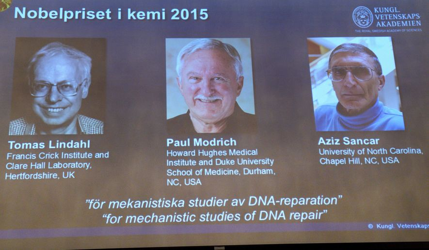 """A view of the screen showing the winners of the 2015 Nobel Prize for Chemistry, during a press conference,  in Stockholm, Wednesday, Oct. 7, 2015. Sweden's Tomas Lindahl, American Paul Modrich and U.S.-Turkish scientist Aziz Sancar won the Nobel Prize in chemistry on Wednesday for """"mechanistic studies of DNA repair."""" (AP Photo)"""