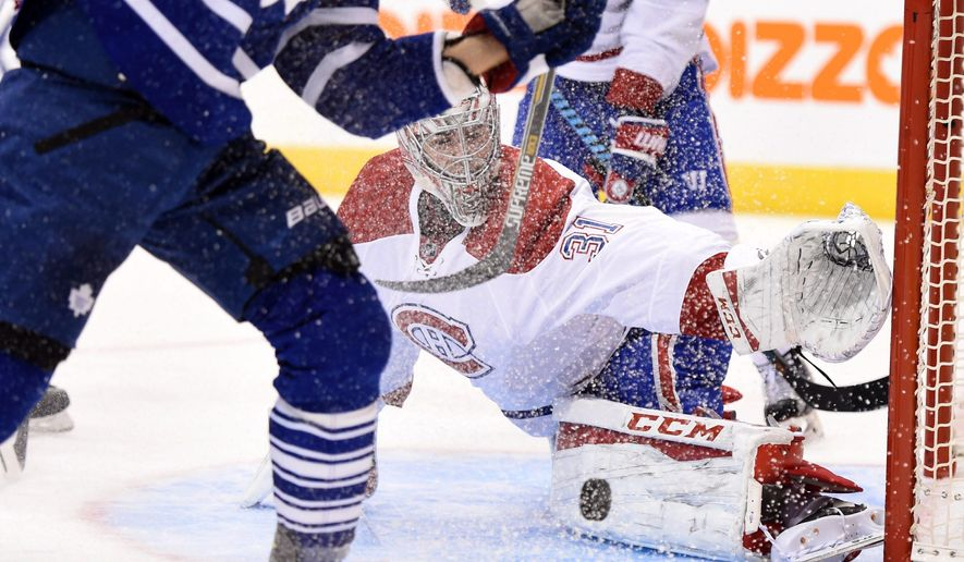 Montreal Canadiens goalie Carey Price makes a pad save against the Toronto Maple Leafs during the second period of an NHL hockey game, Wednesday, Oct. 7, 2015 in Toronto.  (Frank Gunn/The Canadian Press via AP) MANDATORY CREDIT