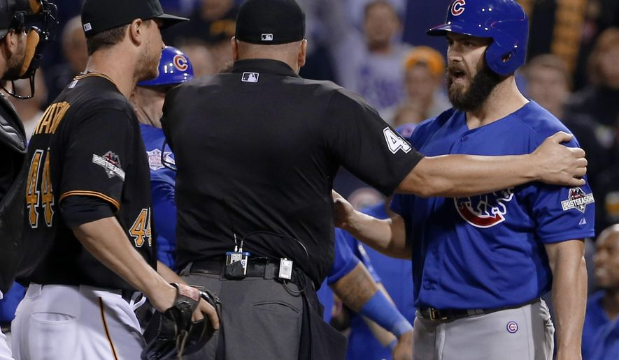 Chicago Cubs starting pitcher Jake Arrieta, right, speaks to Pittsburgh Pirates relief pitcher Tony Watson, left, after he was hit by a Watson pitch in the seventh inning of the National League wild card baseball game, Wednesday, Oct. 7, 2015, in Pittsburgh. (AP Photo/Gene J. Puskar)