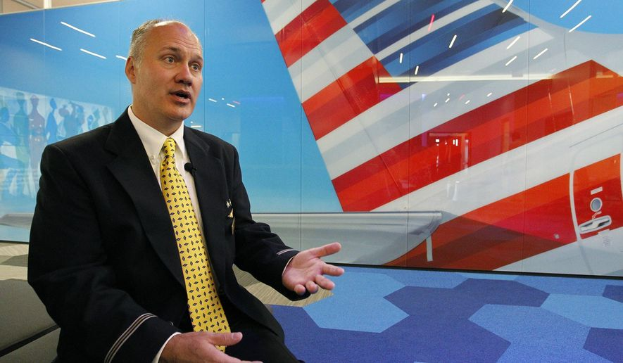 In this photo taken on Monday, Oct. 5, 2015, flight attendant Jeff Gross, from Euless, who was a member of the American Airlines crew and staff that flew Pope Francis on his recent visit to the United States, speaks about his experience at the AA Integrated Operations Center in Fort Worth, Texas. (Paul Moseley/Star-Telegram via AP) MAGS OUT; (FORT WORTH WEEKLY, 360 WEST); INTERNET OUT; MANDATORY CREDIT