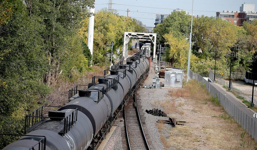 A train made its way along the tracks near downtown Minneapolis, MN, Tuesday, Oct. 6, 2015.  growing number of trains that each carry at least 1 million gallons of oil from North Dakota have been entering the Twin Cities via the western suburbs on a route that sends them and their hazardous cargo through downtown Minneapolis. (Elizabeth Flores/Star Tribune via AP)  MANDATORY CREDIT; ST. PAUL PIONEER PRESS OUT; MAGS OUT; TWIN CITIES LOCAL TELEVISION OUT