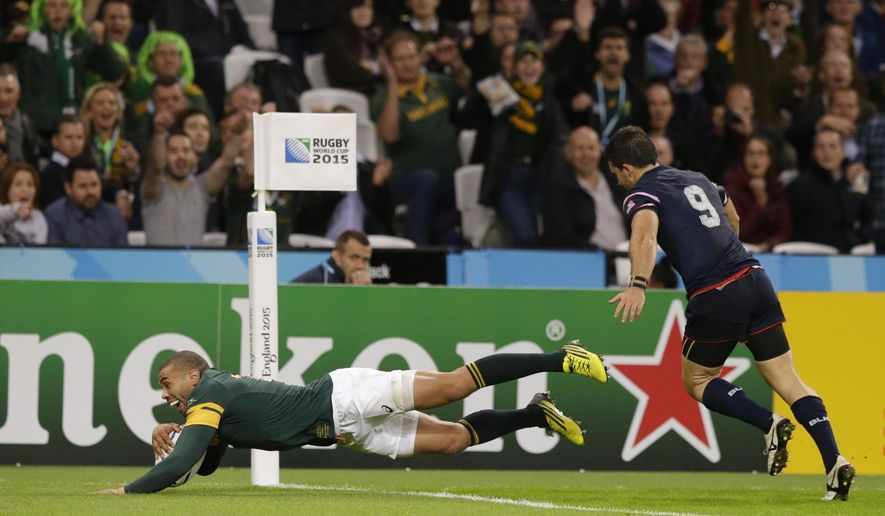South Africa's Bryan Habana scores his third try during the Rugby World Cup Pool B match between South Africa and USA at the Olympic Stadium, London, Wednesday, Oct. 7, 2015. Bryan Habana has now tied New Zealand's Jonah Lomu's record for the most Rugby World Cup tries. (AP Photo/Matt Dunham)