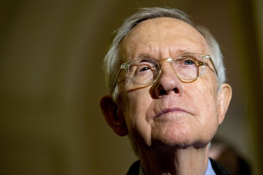 Senate Minority Leader Harry Reid of Nevada listens during a news conference on Capitol Hill in Washington on Oct. 6, 2015. (Associated Press) **FILE**