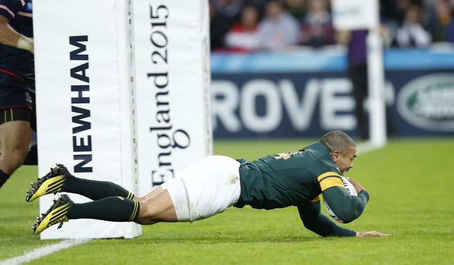 South Africa's Bryan Habana scores a try during the Rugby World Cup Pool B match between South Africa and USA at the Olympic Stadium, London, Wednesday, Oct. 7, 2015. (AP Photo/Christophe Ena)