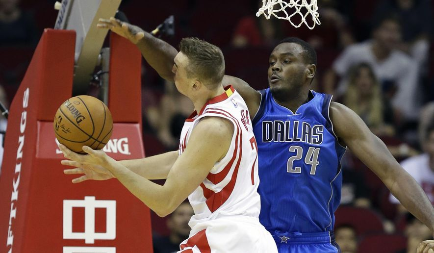 Dallas Mavericks' Samuel Dalembert (24) gets in the face of Houston Rockets' Sam Dekker (7) in the first half of a preseason NBA basketball game Wednesday, Oct. 7, 2015, in Houston. (AP Photo/Pat Sullivan)